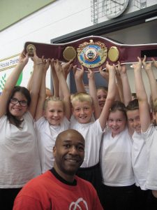 Jones holding up his WBO belt.