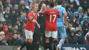 Scholes makes his second debut for United in a Manchester derby.