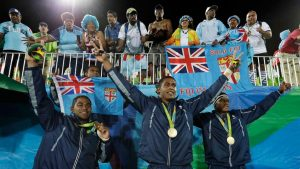 Fiji celebrating with their Olympic gold medals (Credit: Associated Press)