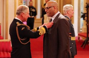 john-amaechi-is-made-an-officer-of-the-british-empire-obe-by-the-prince-of-wales-pic-pa-631098199