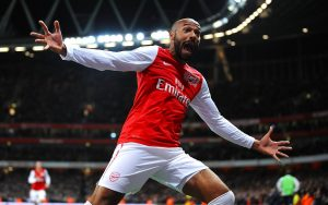 Henry celebrates after scoring the winner on his return to Arsenal.