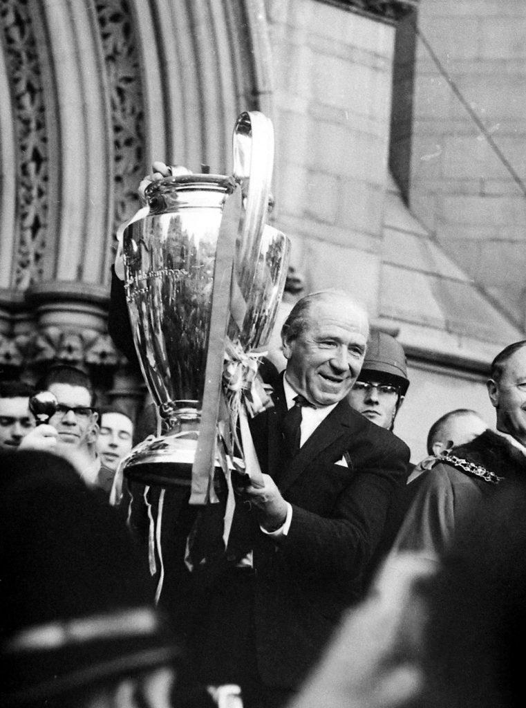 Matt Busby holds the European Cup aloft outside Manchester Town Hall, June 1968.